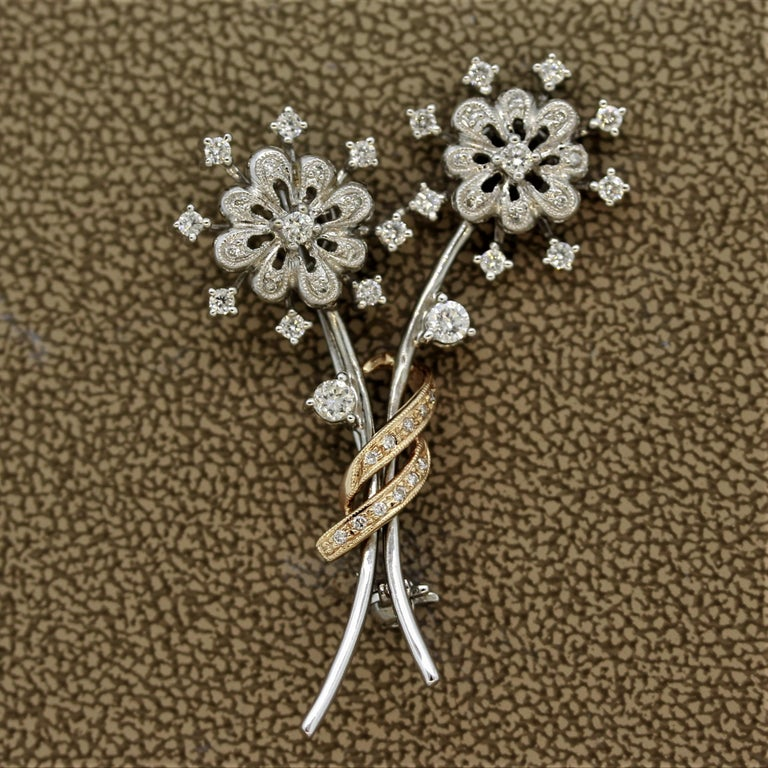 A sweet pin of a two-flower bouquet. They feature 0.75 carats of round brilliant cut diamonds set in 18k white and rose gold. Small enough to be worn daily and with multiple outfits.  Length: 1.9 inches