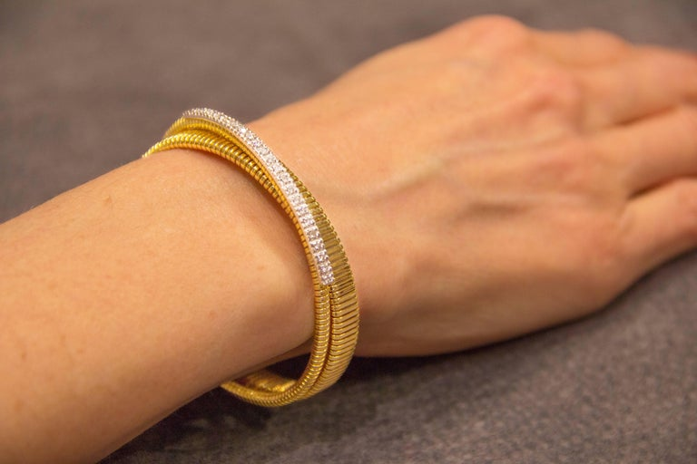A tubogas 18 karat yellow gold bangle, hand crafted in Italy, set with diamonds. All Jona jewelry is new and has never been previously owned or worn. Each item will arrive at your door beautifully gift wrapped in Jona boxes, put inside an elegant