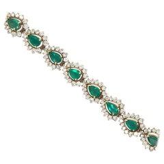 Diamond Halo Bracelet with Pear Shape Emeralds 13.25 Carat 18 Karat Gold