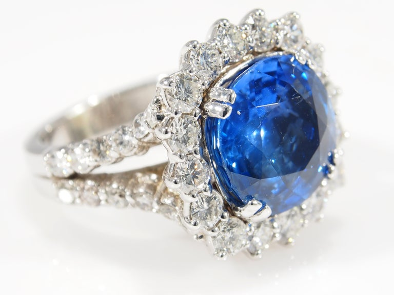 This is a stunning 18K White Gold Diamond and Sapphire Ring. A classically designed ring with a magnificent 8.60ct Cushion Cut Sapphire that is accented by a sparkling Diamond Halo. The Sapphire has a GIA Certificate #1182586049. There are (40)