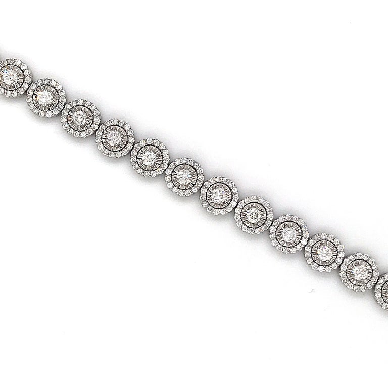 14K White gold halo tennis bracelet featuring 373 round brilliants weighing 5.15 carats.  Color G-H Clarity SI