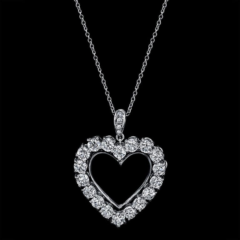 Diamond Heart  2.85 Carats Necklace/Pendant 18K White Gold  Total Carat Weight of Round Diamonds 2.80 carats  Total Carat Weight of Small Diamonds  0.05 carat  F/G Color, VS/SI Clarity  Total Carat Weight 2.85 carats  Set in 18K  White Gold   With