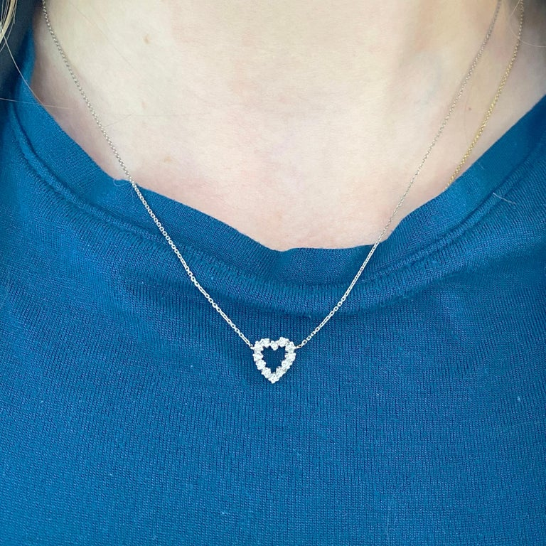 This gorgeous 14k white gold open heart pendant dripping with diamonds is sure to put a smile on anyone's face! This necklace looks beautiful worn by itself and also looks wonderful in a necklace stack. This necklace would make a wonderful gift for