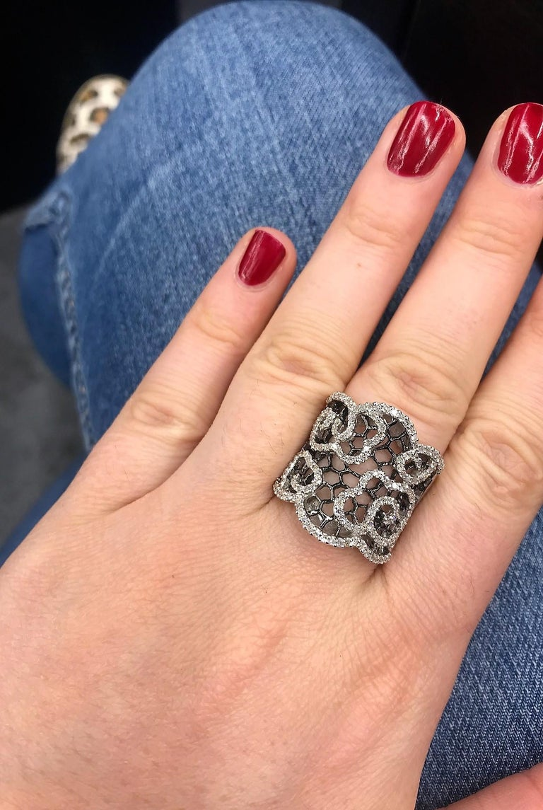 14K White gold honeycomb ring featuring round brilliants weighing 0.80 carats. Very comfortable on the finger!