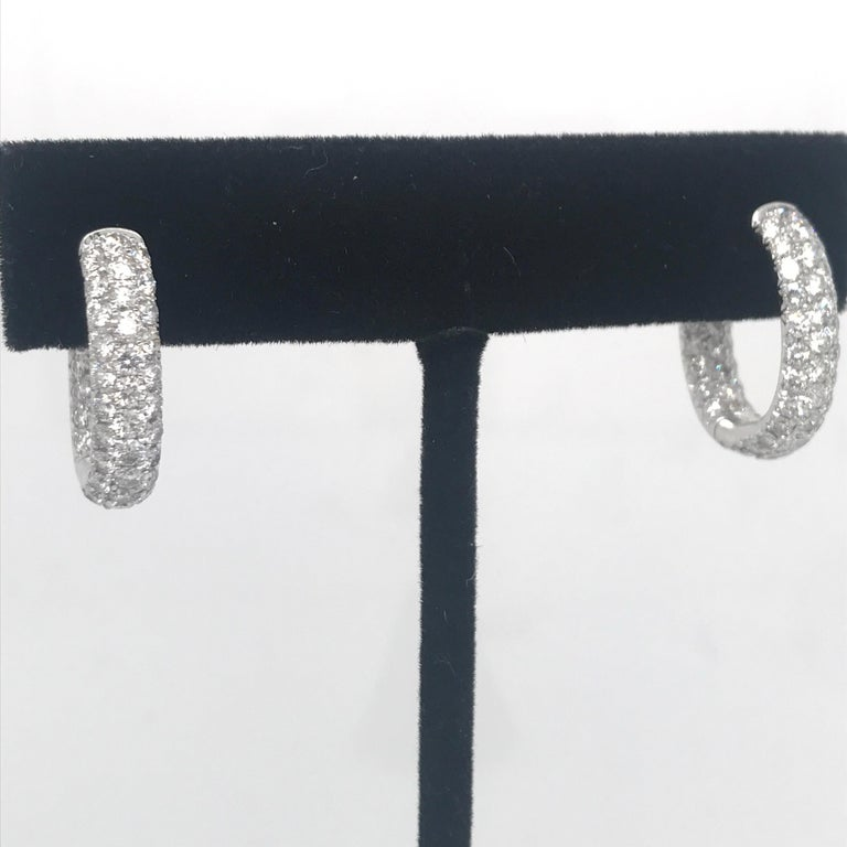 18K White gold hoop earrings featuring 122 round brilliants weighing 2.95 carats.
