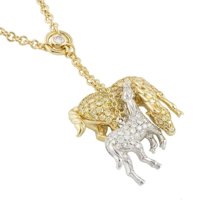 A unique large 18k yellow and white gold diamond Horse pendant. The pendant comprises of 2 Horse motifs set with round brilliant cut pave diamonds and 6 rubover set diamonds set throughout the chain. One Horse is 18k yellow gold set with round