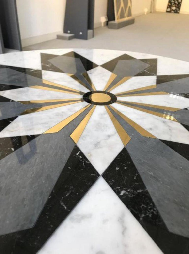 This diamond inlay table is designed by Davide Silvestri of Carrara, Italy.   The materials used for this particular edition of 30 include white Carrara marble, Nero Marquina, grey Imperiale marble and brass inlays. Base material and dimensions can