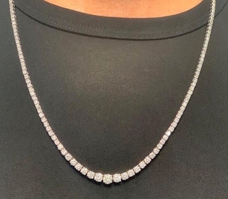 205 Diamonds in a 14 karat white gold graduated diamond necklace and matching bracelet ( 6 1/2 inch)  that can be connected (22.5 inches) to the 16 inch necklace. The necklace has a  139 diamonds with a total weight of 10.22 carats and the bracelet