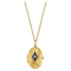 Diamond Oval 22k Gold Locket with Oxidized Silver