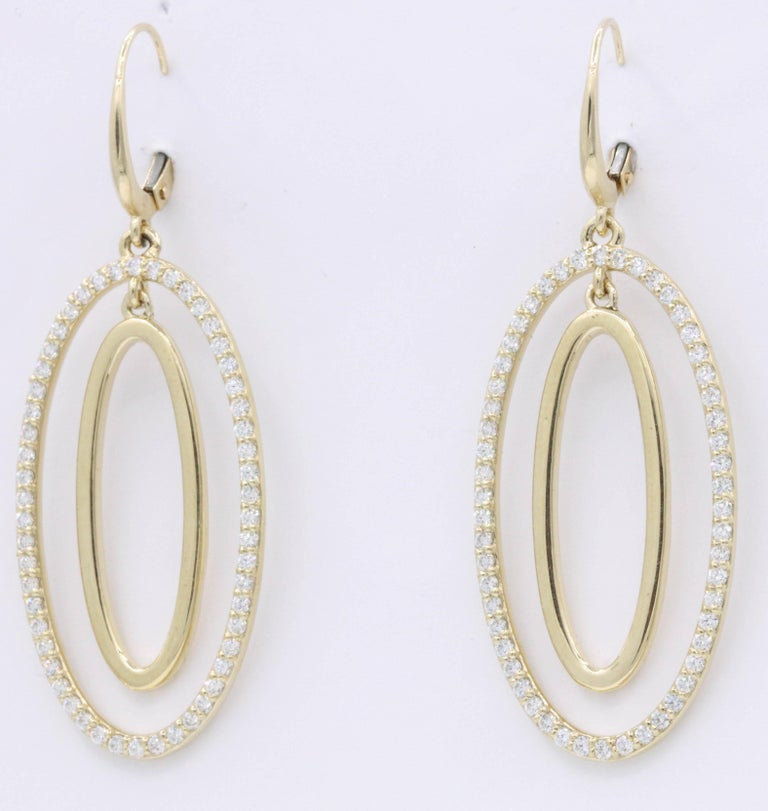 These fun and playful hoop earrings feature 108 round brilliants weighing 1.10 carats, crafted in 14k yellow gold. Very wearable and can be dressed up or down!