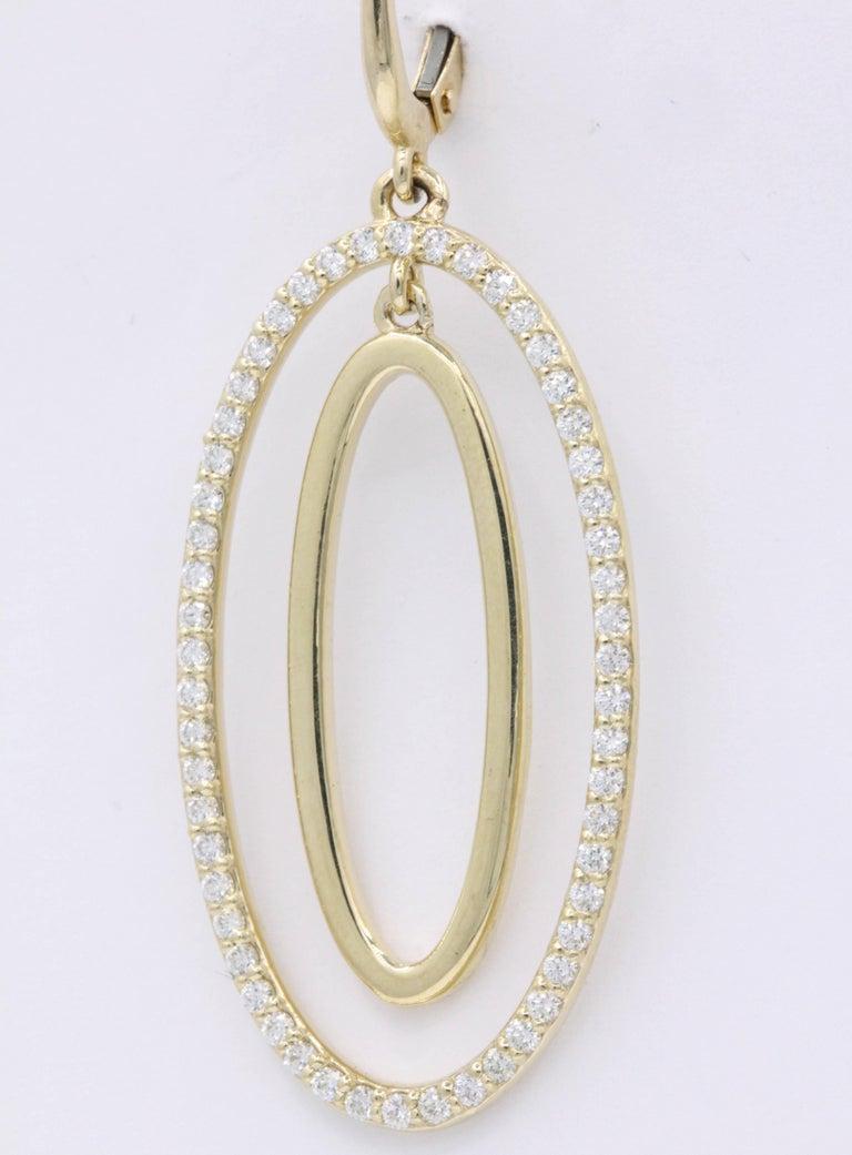 Contemporary Diamond Oval Hoop Earrings, 1.10 Carat For Sale