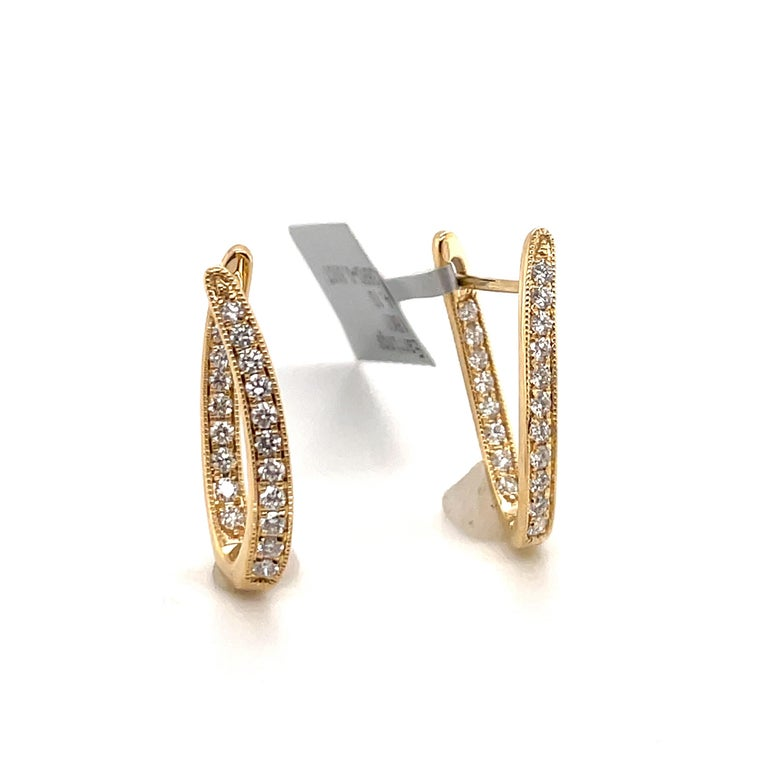 18K Yellow gold inside out hoop earrings featuring 38 round brilliants weighing 0.61 carats. Color G-H Clarity SI