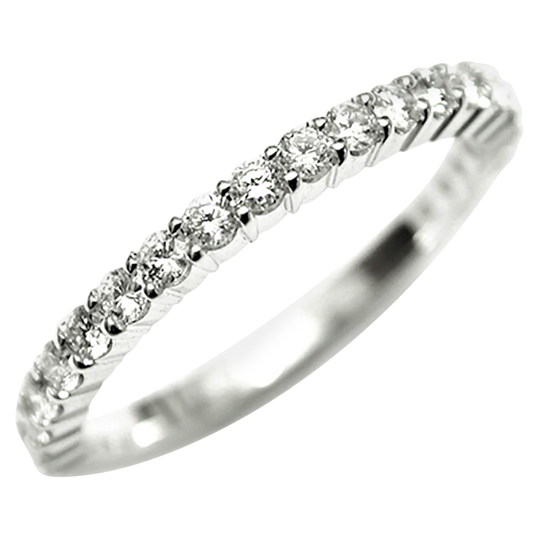 Eighteen Karat White Gold Fifteen Diamonds Partial Prong Set Band