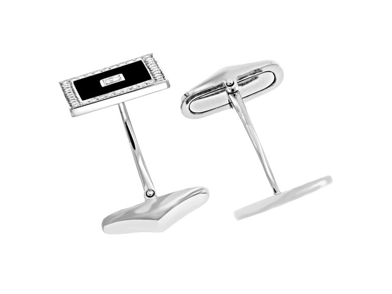 Every worldly gentleman needs a pair of sophiscated cufflinks. These 18k white gold cufflinks feature square diamonds surrounded by black enamel. Pave'd diamonds are set around the enamel for the finishing touch.