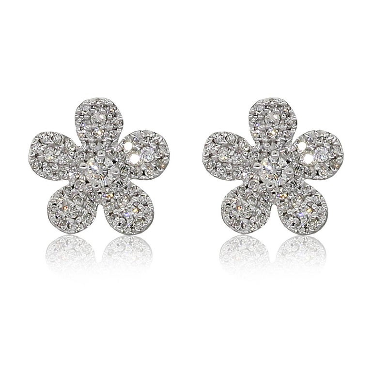 Material: 14k white gold Diamond Details: Approximately 0.35ctw round brilliant cut diamonds. Diamonds are I/J in color and SI3 in clarity. Measurements: 0.52″ x 0.34″ x 0.35″ Earring Backs: Post friction Item Weight: 2.03g (1.3dwt) Additional