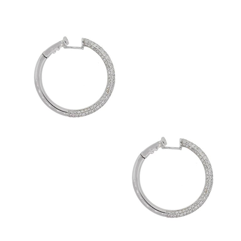 Material: 18k white gold Diamond Details: Approximately 2.33ctw of round brilliant diamonds. Diamonds are G/H in color and VS in clarity Earring Measurements: 1.25″ x 0.12″ x 1.25″ Earring backs: Hinged Total Weight: 14.7g (9.5dwt) Additional