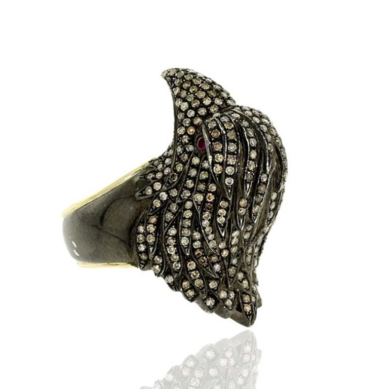 Cool looking Diamond Pave Raven Ring set in silver and 14K yellow gold.  Ring Size: US-7.5  14kt Gold:1.18g Diamond:2.05ct, RUBY:0.08Cts