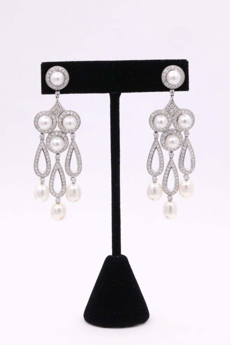 Art Deco inspired earrings featuring round brilliants weighing 3.13 carats with touches of round and oval shape pearls.  Color G Clarity SI A real show stopper!