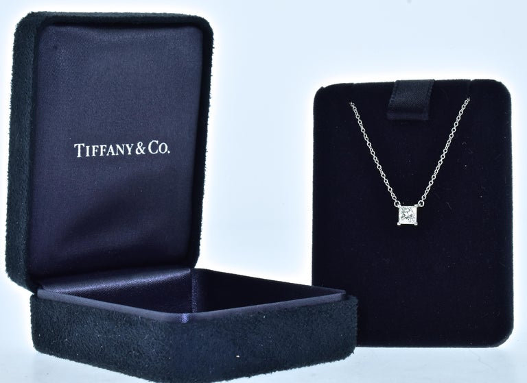 Tiffany & Co. platinum and fine diamond necklace all original, in fine condition and with the original box.  The fine white square radiant- cut diamond possesses fine symmetry, and is estimated to be near colorless (G), and very very slightly