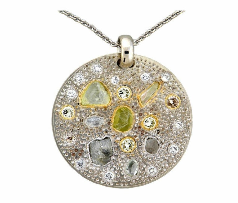 ROUGH TO POLISHED DIAMONDS  One of a kind! ART WORK PIECE  TOTAL DIAMOND  7 Rough Diamond 5.90 carats  17 Polished Diamond 2.20 carats  White Polished Diamonds are F/G Color VS Clarity  Total Carat Weight 8.10 carats  Set in 18 Karat White & Yellow