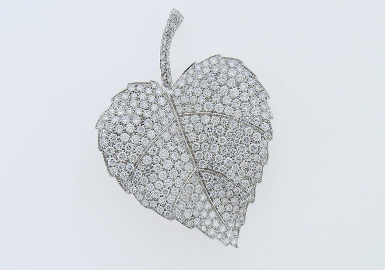 Beautiful diamond brooch designed as a leave. Weight of the brooch is 17.98 grams. Embellished with 9.30 carats round diamonds of F-G color and VS clarity.  Mounted in 18K White Gold. Length of brooch is 2.70 inch.  Width is 1.75 inch