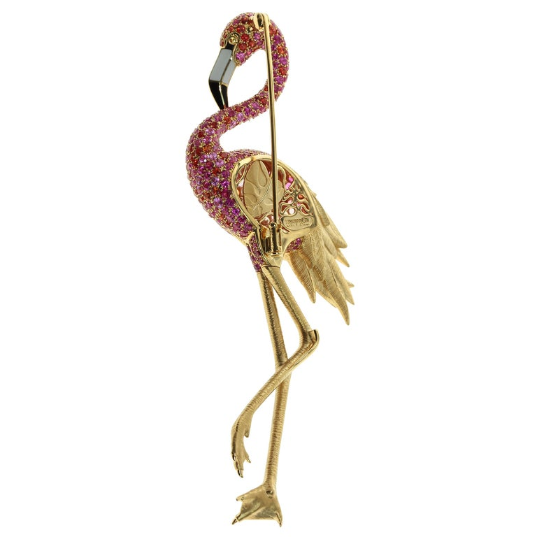 Diamond Pink Orange Sapphire Enamel 18 Karat Yellow Gold Flamingo Brooch We decided to represent one of the most beautiful birds on earth - flamingos. The bird is made of 18 Karat Yellow Gold. The legs are made so realistic that every wrinkle and