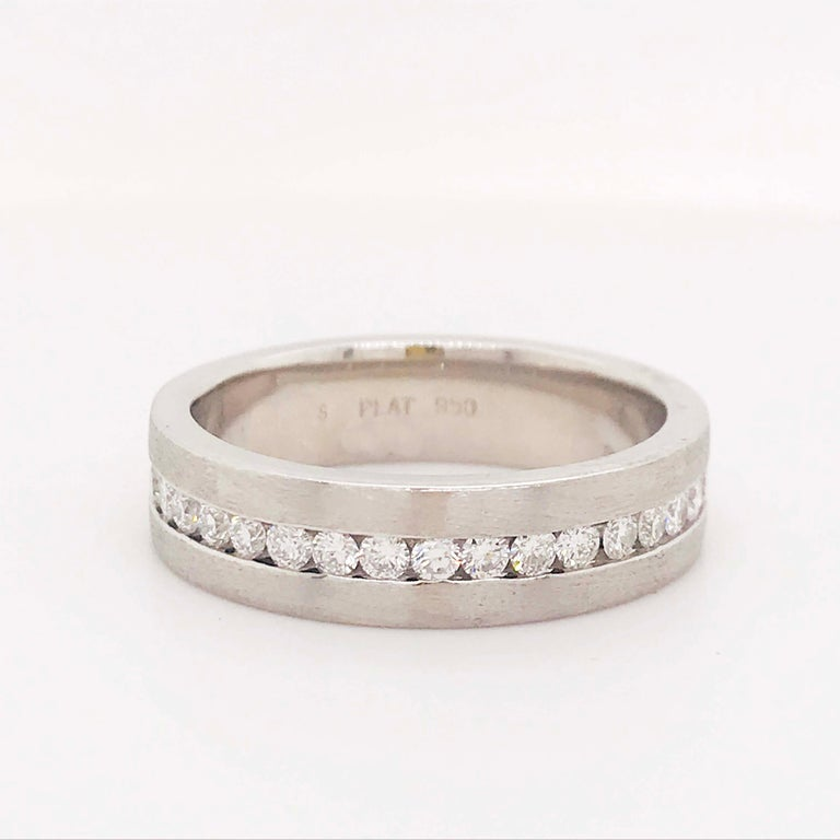 Modern diamond and platinum men's wedding band. This authentic platinum and diamond design is modern and classy! The 6mm wide men's band is made of the precious metal platinum. With genuine round brilliant diamonds set in a clean channel setting.