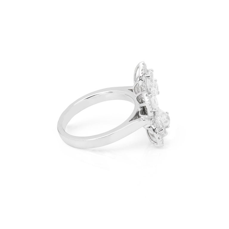 This Ring features Five Pear Cut Diamonds Totalling 1.57cts with Micro Set Round Briliant Cut Diamonds to the outer edge totaling 0.67cts. Set in Platinum. Ring size UK L1/2, EU Size 52, USA Size 6. Complete with Xupes Presentation Box. Our Xupes