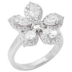 Diamond Platinum Micro Set Pear and Round Brilliant Cut Diamond Cluster Ring