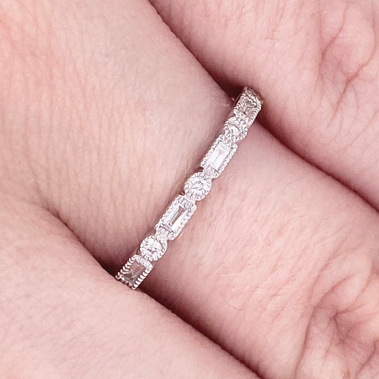 This stunningly beautiful milgrain white gold band dripping with alternating round and baguette diamonds provides a look that is very classic and modern at the same time! This ring is very fashionable and can add a touch of style to any outfit, yet
