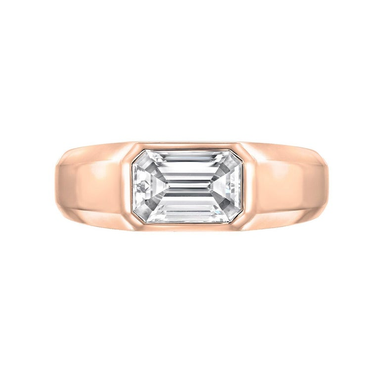 Emerald Cut diamond ring featuring a G.I.A certified 1.02 carat E color and VVS2 clarity emerald cut diamond, set in a pristine, hand crafted, 18K rose gold unisex ring.  The G.I.A certificate is attached to the images for your convenience.  Please