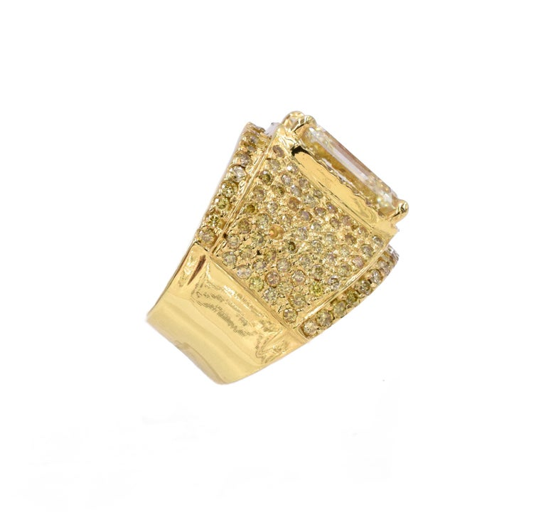 NALLY Impressive Diamond Ring with 10.44 carat emerald-cut diamond.  Champagne Color, VS2 clarity with 4ct of yellow round diamonds all set in 18k yellow gold. Finger Size: 8 ( resizable)