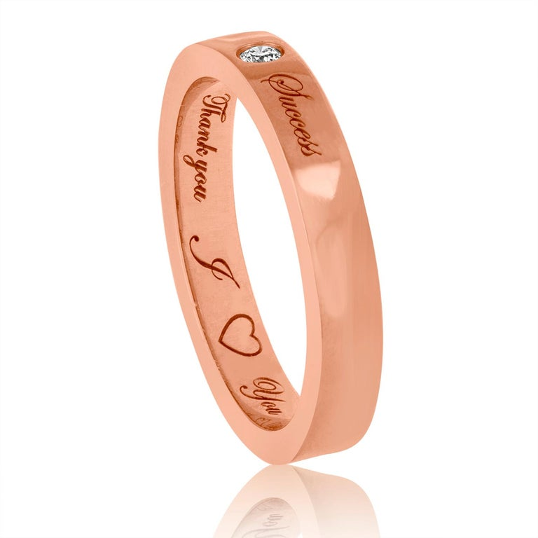 Very unusual wedding band. The band is 18K Rose Gold. There are 0.03 Carat Diamond G SI. There are three inscriptions:.