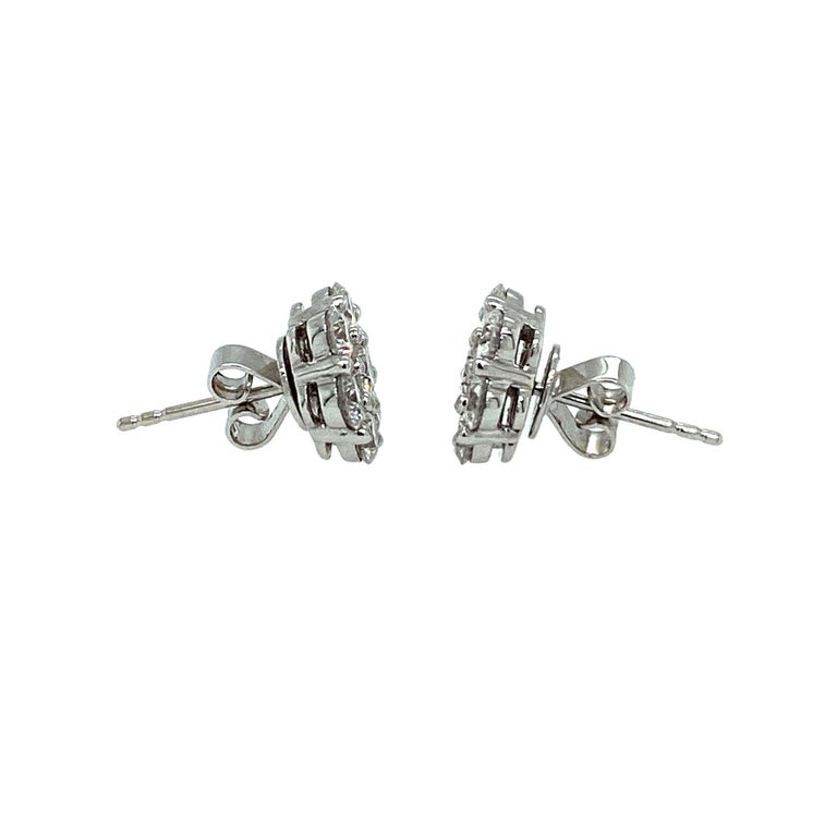 Rose Shaped Diamond Stud Earrings made with natural brilliant cut diamonds. Total Weight: 2.03 carats, Diamond Quantity: 14 (round diamonds), Color: H. Set on 18 karat white gold, pushback setting.