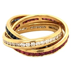 Diamond, Ruby and Sapphire Trinity Ring in Yellow Gold