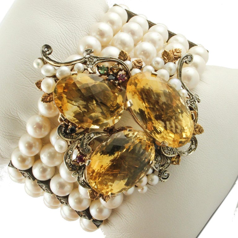 Gourgeous beaded retrò bracelet composed of 73.88 gr of 5 white pearls rows, 9K rose gold and silver closure and drop shape central part adorned with 15.80 g of 3 amazing yellow topazes, embellished all around by 0.61 ct of little diamonds, 0.75 ct