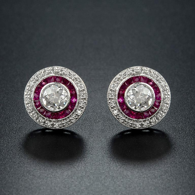 Diamond Ruby Stud Earrings, one of the most popular  Art Deco Style.   Center Diamond ( G color VS Clarity, round, size 4.7 mm.) 2 pieces 0.72 Carat. French Cut Natural Ruby 34 pieces  2.38 carat. Surrounding with Diamond (Round 1.1 mm.) 40 pieces