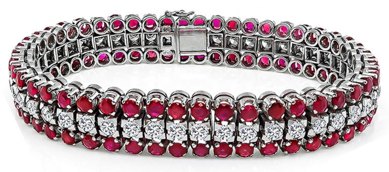 This elegant 18k white gold bracelet is set with sparkling European cut diamonds that weigh approximately 3.75ct. graded H color with VS clarity. The diamonds are accentuated by lovely round cut rubies that weigh approximately 9.00ct. The bracelet
