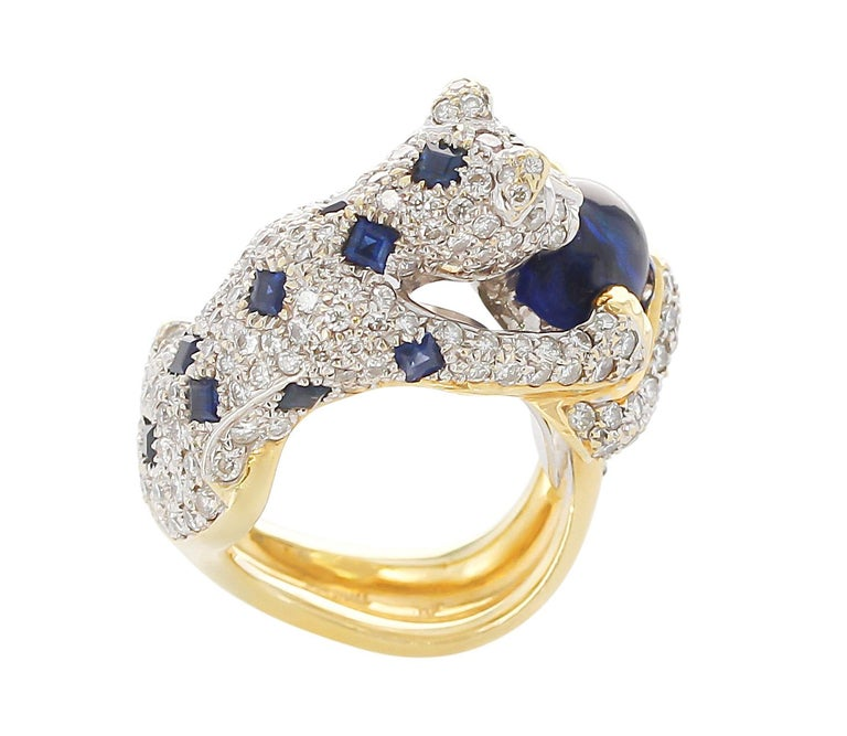 Round Cut Diamond, Sapphire, and Emerald Panther Ring, 18 Karat Gold For Sale