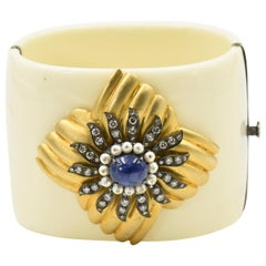 Diamond, Sapphire, and Pearl Gold Floral Accent on a Bakelite Bangle Bracelet