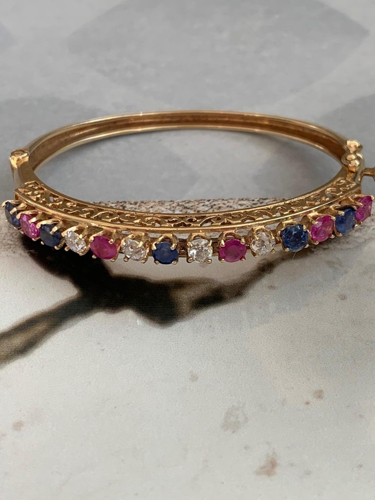 Diamond, Sapphire and Ruby 14 Karat Gold Bangle Bracelet In Excellent Condition For Sale In St. Paul, MN