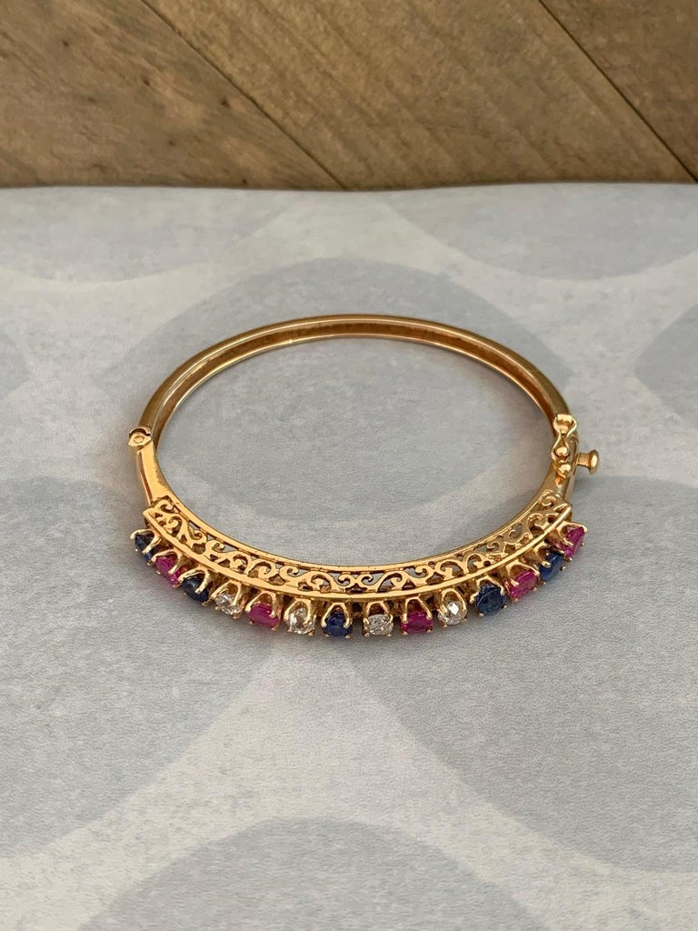 Women's Diamond, Sapphire and Ruby 14 Karat Gold Bangle Bracelet For Sale