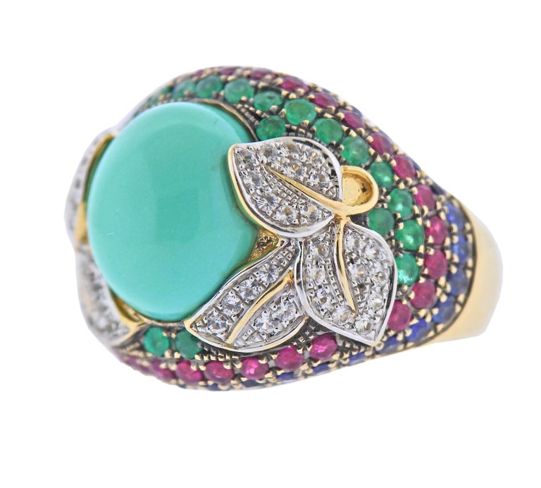 14k gold cocktail ring, featuring sapphires, emeralds, rubies, diamonds and center turquoise. Ring size - 4.5, ring top is 18mm wide. Marked 14k, China FP. Weight - 11.4 grams.