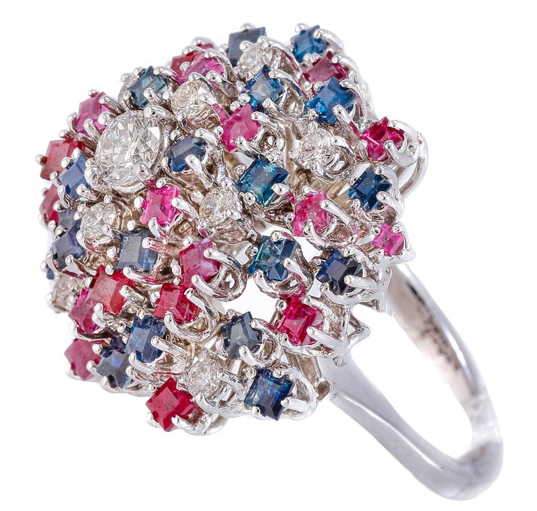 Wonderful ring in 18 kt white gold totally enriched with sapphires and rubies of ct 3.44 and is alternated with diamonds of ct 0.28 of which the central diamond 0.39. Total weight g 11.8. Sapphires and Rubies ct 3.44 Diamonds ct 0.28 + D. central