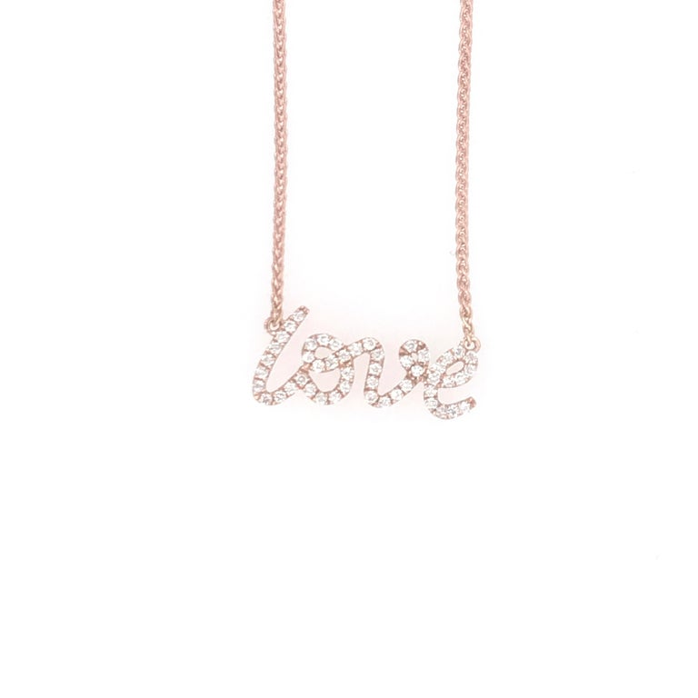 18K Rose Gold necklace featuring a diamond LOVE weighing 0.16 carats.  2.3 grams Great for layering!