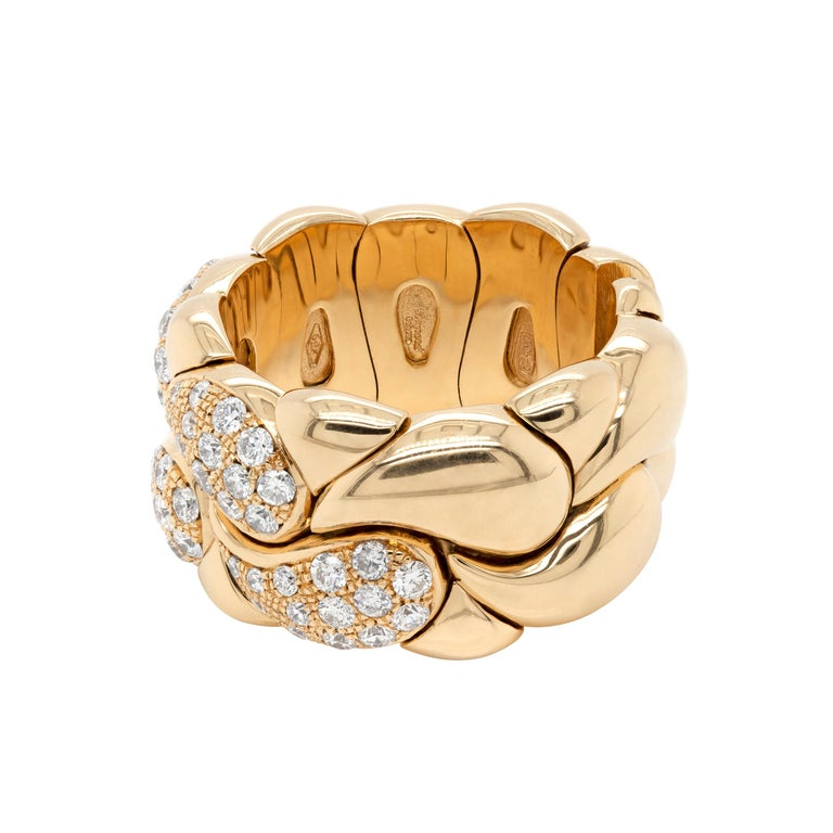 Chopard flexi ring from their classic Casmir collection set with 56 fine quality round brilliant cut diamonds weighing a total of 0.78 carat all pave set in 18 carat yellow gold. The diamonds have been after set on the original Chopard ring to