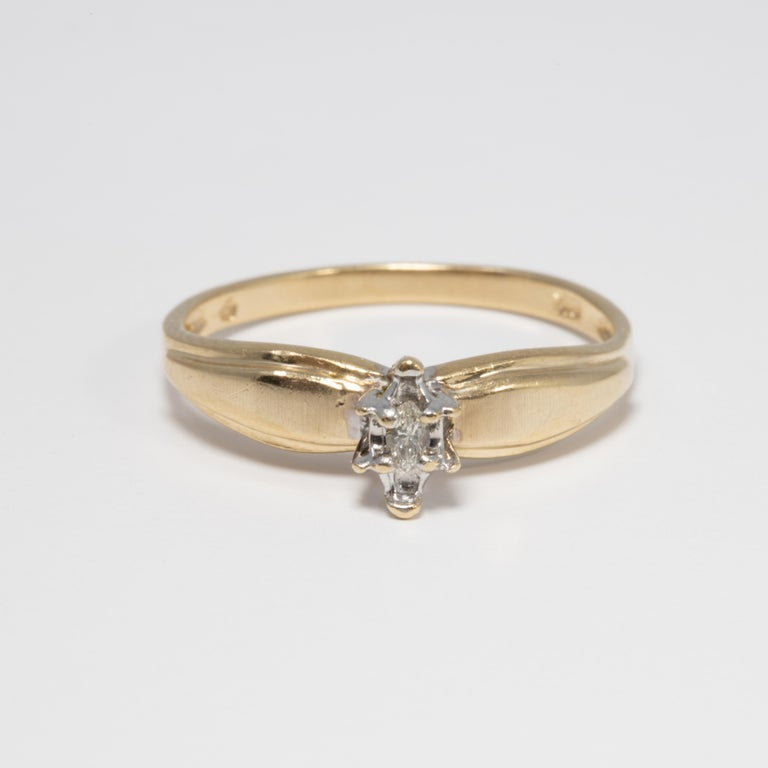 Marquise Cut Diamond Solitaire Ring, 14 Yellow and White Gold Raised Setting, .05 ct Marquise For Sale