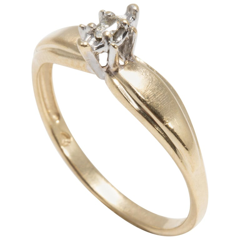 Diamond Solitaire Ring, 14 Yellow and White Gold Raised Setting, .05 ct Marquise For Sale