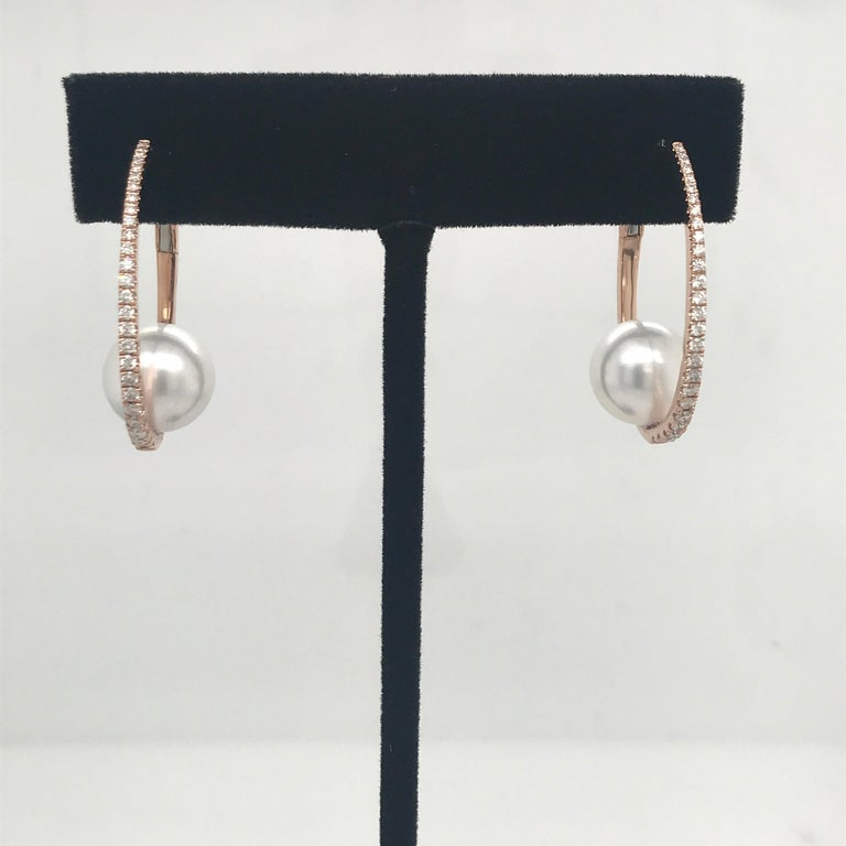 18K Rose Gold diamond hoop earrings weighing 0.55 carats with a 10-11 mm White South Sea Pearl.  Available in all gold & pearl colors.