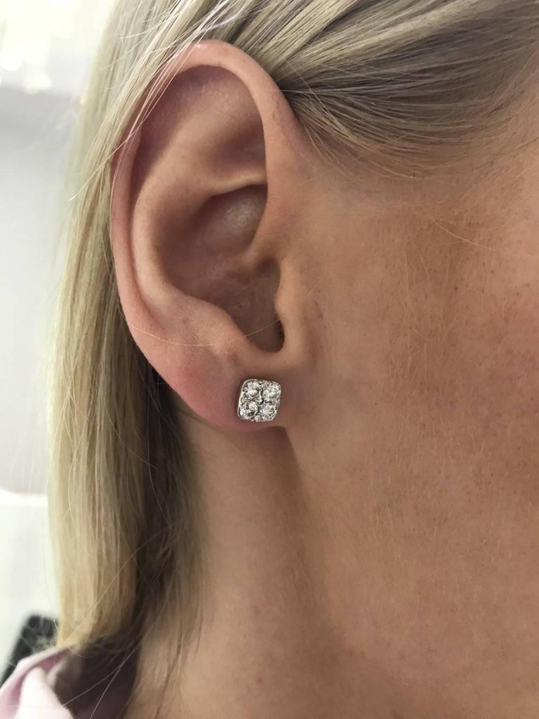 These eye catching elegant Round Brilliant Diamond cluster stud earrings featuring white colour H - clarity SI diamonds that sparkle, set in 18 Karat White Gold. These curved-corners square shaped pave set cluster studs have a total diamond weight